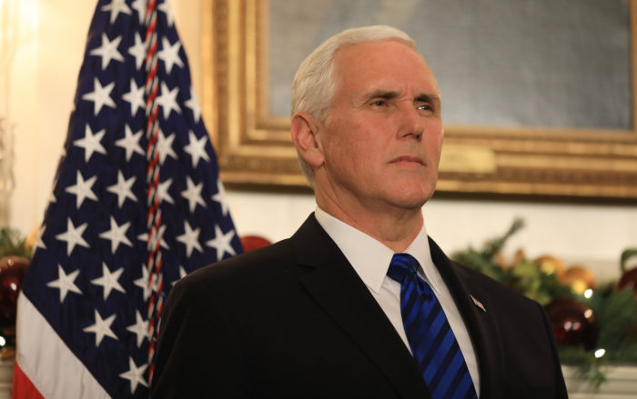 epa06371845 US Vice President Mike Pence listens as US President Donald Trump delivers his controversial decision to formally recognize Jerusalem as the capital of Israel, and his plan to relocate the US embassy to that city, in the Diplomatic Room of the White House in Washington, DC, USA 06 December 2017. The move breaks with years of American foreign policy and could lead to unrest in the Middle East. EPA/JIM LO SCALZO