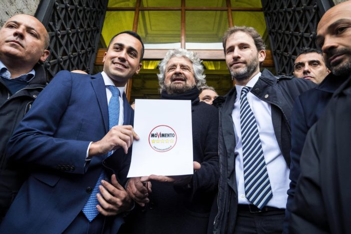 epa06453007 Beppe Grillo (C), Luigi Di Maio (2-L) and Davide Casaleggio (2-R) pose for the media in front of the Italian Interior Ministry after presenting the new symbol of the Five-Star Movement (M5S) for the 04 March general election, in Rome, Italy, 19 January 2018. Others are not identified. EPA/ANGELO CARCONI