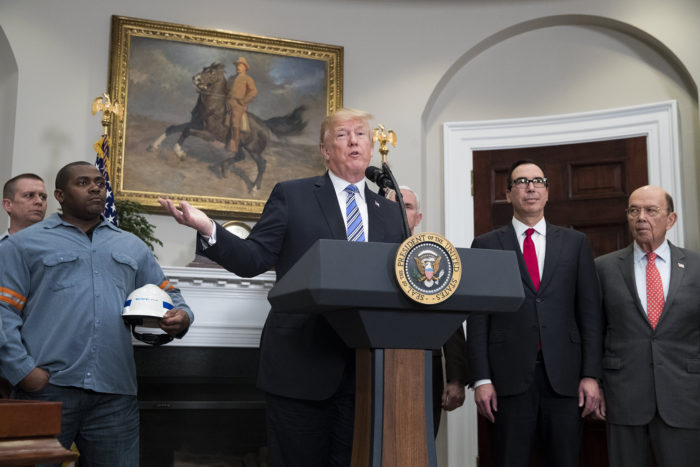 epa06590390 US President Donald J. Trump (C) delivers remarks beside workers (L), US Treasury Secretary Steven Mnuchin (2-R) and US Commerce Secretary Wilbur Ross (R), before signing a presidential proclamation on steel and aluminum tariffs, in the Roosevelt Room of the White House in Washington, DC, USA, 08 March 2018. President Trump is imposing tariffs on steel and aluminum imports. A decision to impose the tariffs on Canada or Mexico will not be decided until negotiations on the North American Free Trade Agreement (NAFTA).  EPA/MICHAEL REYNOLDS
