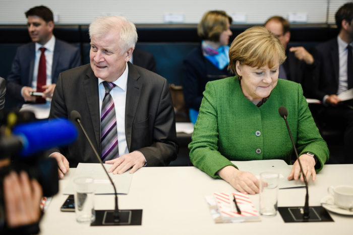 epa06689175 German Chancellor and Chairwoman of the Christian Democratic Union (CDU), Angela Merkel (R) and German Minister of Interior, Construction and Homeland and chairman of the German Christian Social Union (CSU) Horst Seehofer (L) sit next to each other during the beginning of a faction meeting in Berlin, Germany, 24 April 2018. The CDU/CSU faction meets on a regular basis at the German Parliament 'Bundestag'.  EPA/CLEMENS BILAN