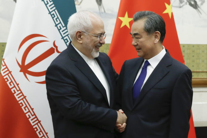 epa06732543 Chinese State Councillor and Foreign Minister Wang Yi meets Iranian Foreign Minister Mohammad Javad Zarif (R) at Diaoyutai state guesthouse in Beijing, China, 13 May 2018.  EPA/THOMAS PETER / POOL
